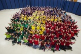The entire student body poses as the 2014 Catholic Schools Week logo.