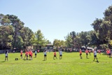 Students enjoy recess on the school's 2.5 acre field each day.  They sometimes use the field for PE class as well.