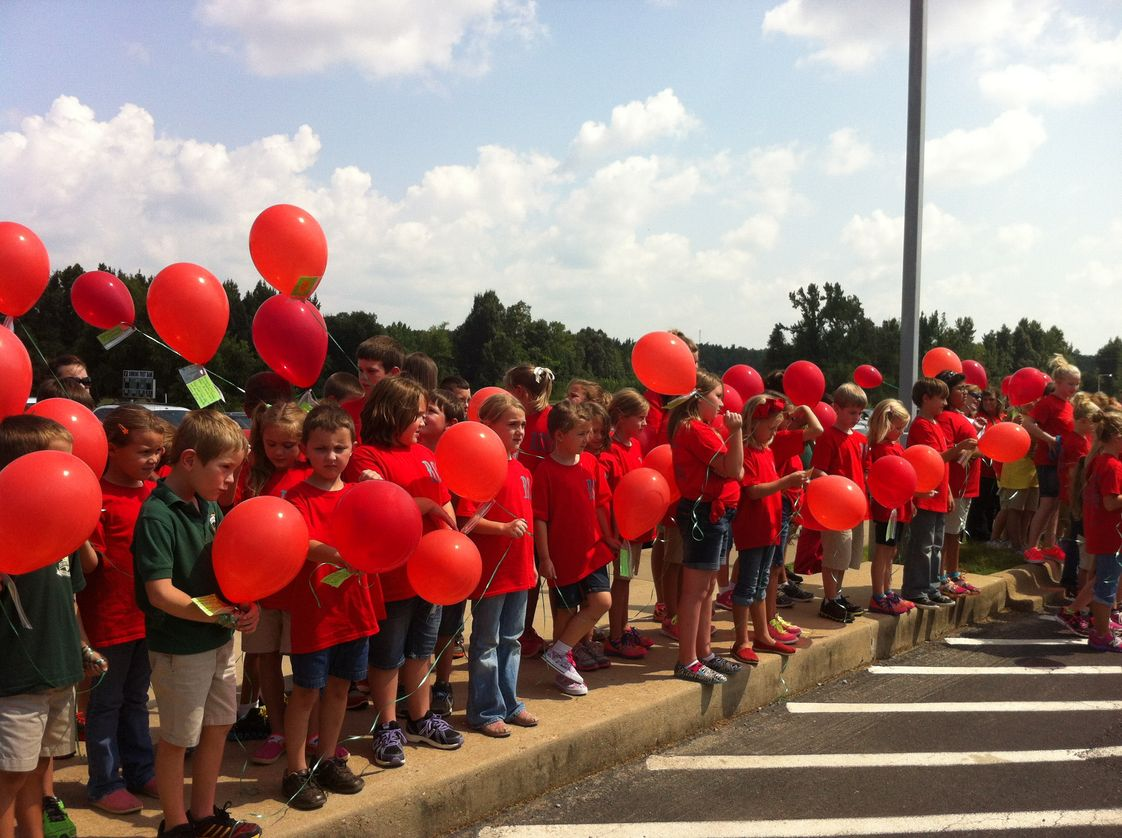 Ridgefield Christian School Photo - Students release balloons with their favorite book inside as the kick-off for Accelerated Reading.