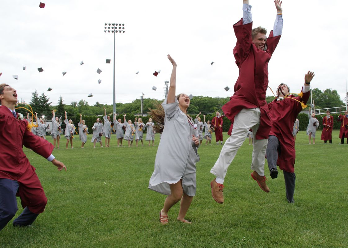 Bishop Stang High School Photo - Immediately following the graduation ceremony, the Class of 2016 gathers for one final time on the front field to celebrate their amazing accomplishments!