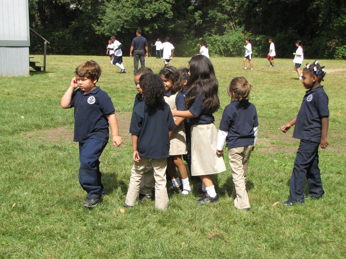 Greater Boston Academy Photo #1 - Students getting ready to come back inside after having recess on the playground.