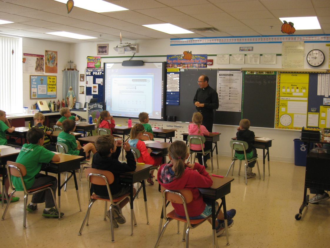 John Ireland School Photo - Pastor Todd visiting the third grade. John Ireland School has 7 classrooms (K-6), each equipped with an interactive smart-board.