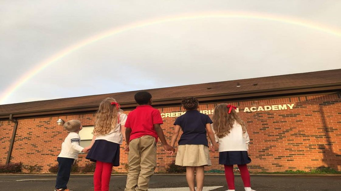 Cross Creek Christian Academy Photo - Students admiring a beautiful rainbow God has provided after a rainy afternoon.