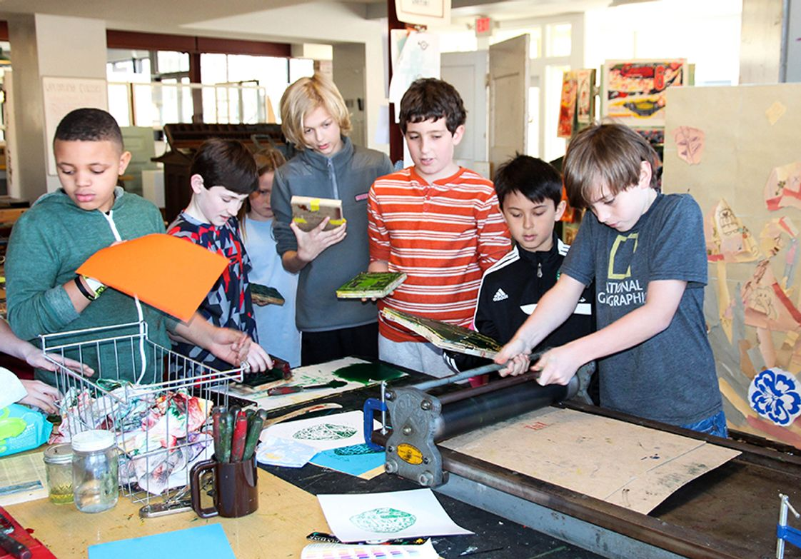Community School Photo #1 - Students learning about printmaking in art class.