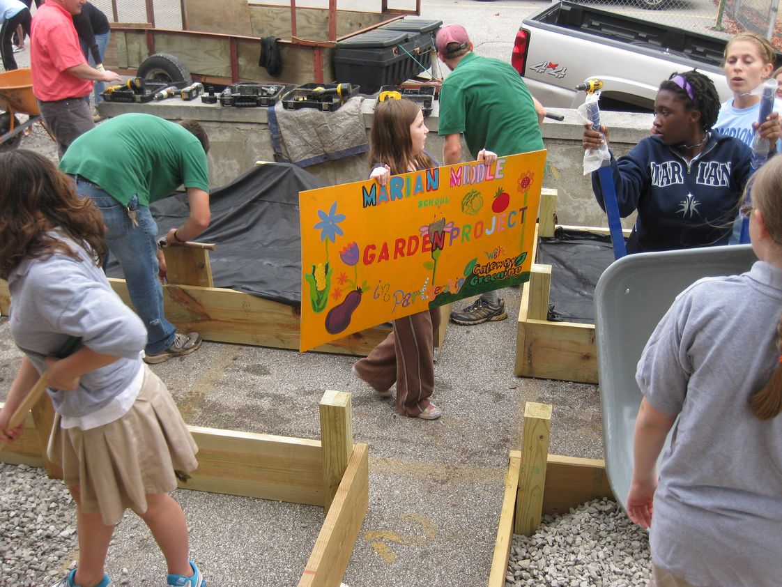 Marian Middle School Photo - Marian Students help to install the community garden.