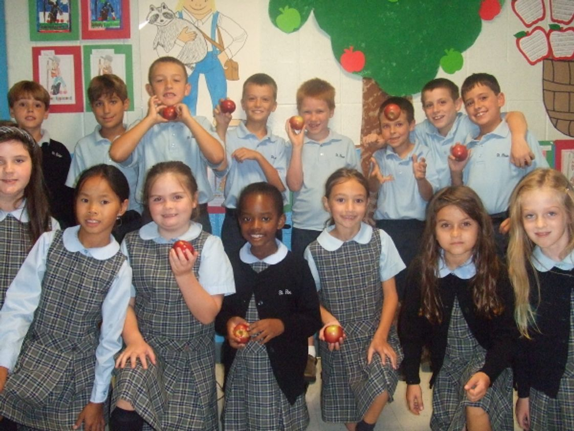 St Rose Grammar School Photo #1 - St. Rose Grammar School third grade students from Ms. Mary Burns' class celebrated Johnny Appleseed's birthday by making homemade applesauce in their classroom.