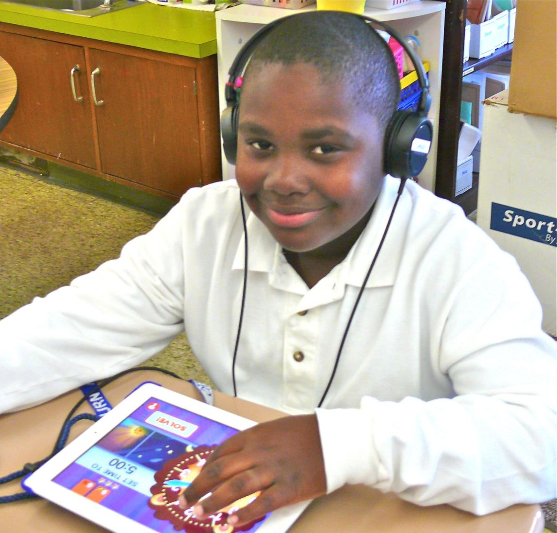 Marburn Academy Photo - Lower Division students use iPads for reading and language.