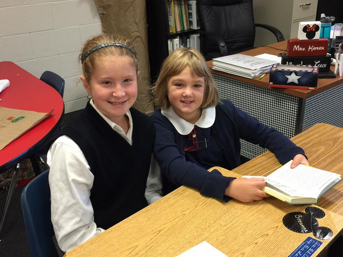 New Hope Christian Academy Photo - 6th Grade collaborative reading with 3rd Grade.