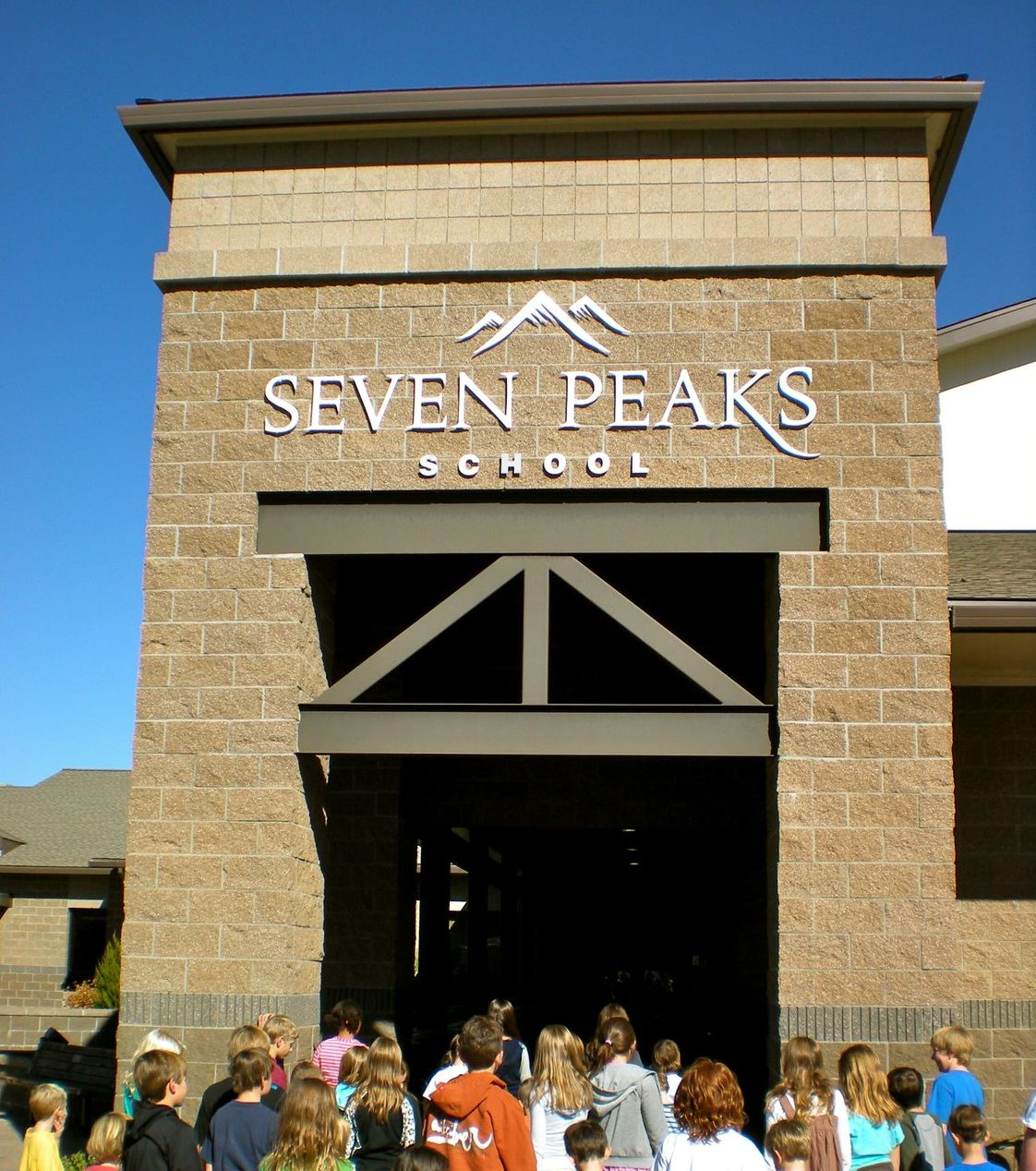 Seven Peaks School Photo - Seven Peaks is proud to be an MYP (Middle Years Programme) IB school. The MYP curriculum framework comprises eight subject groups, providing a broad and balanced education for early adolescents. Students take the core courses of language and literature, individuals and societies, mathematics, sciences, physical and health education, language acquisition, arts, and design.