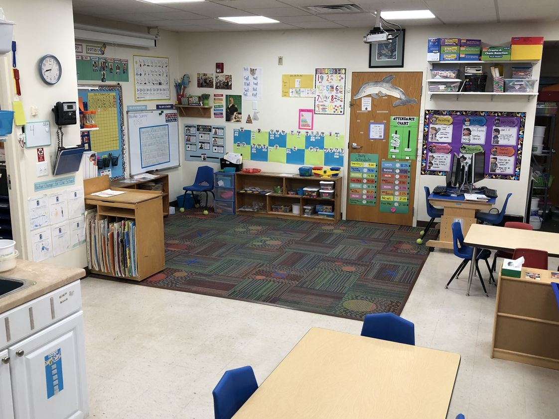Dickinson College Children's Center Photo - Morning Meeting Time includes: word wall, daily schedule, calendar, days of school counting chart, and weather chart. Technology also offered throughout the day.