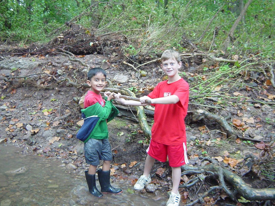 Germantown Academy Photo #1 - Second grade students research various species in the Wissahickon Creek, which runs through the heart of GA's campus.