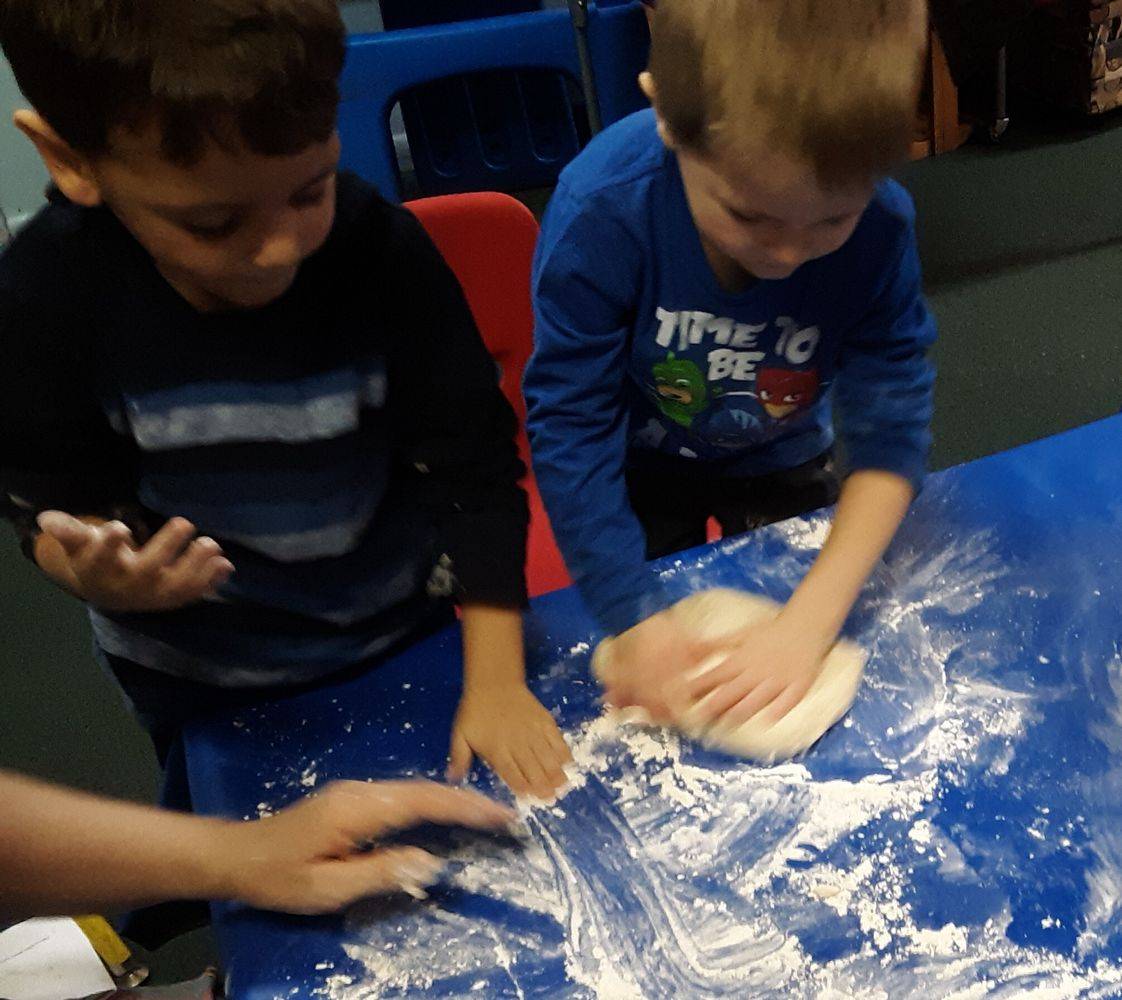 The Nicholas School Photo #1 - We are always creating! Today it was homemade bread.We mixed the dough and had a great time kneading it.