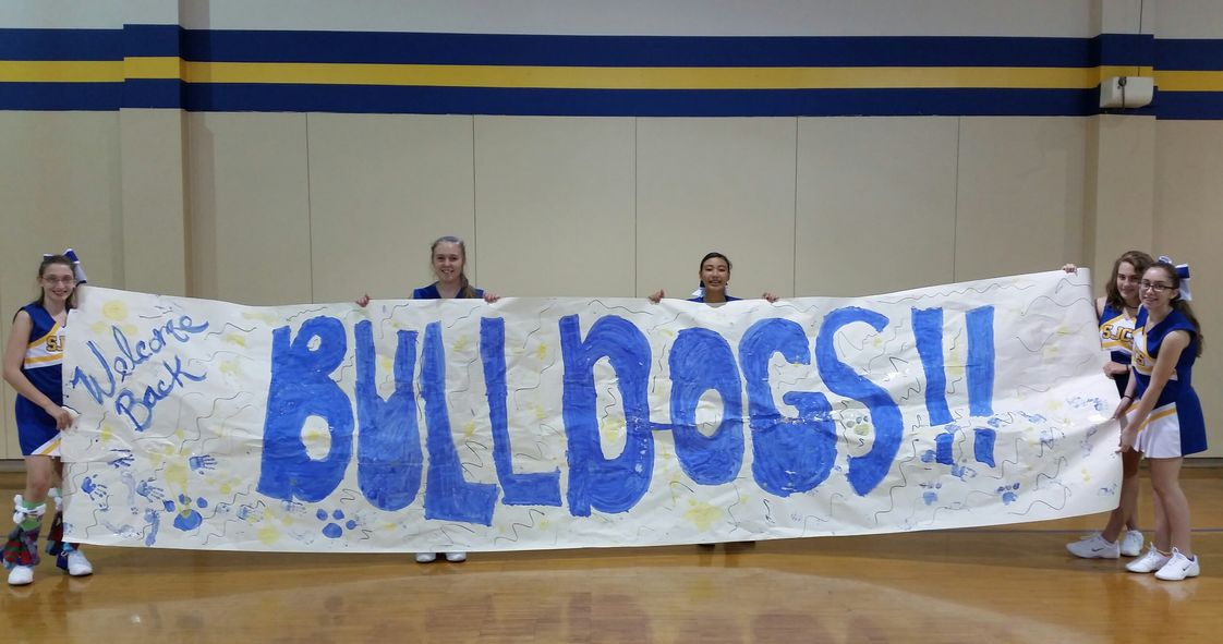 St. Jerome Catholic School Photo - Some of our Cheer leading squad with the first Pep Rally sign of the 2014-2015 School Year.