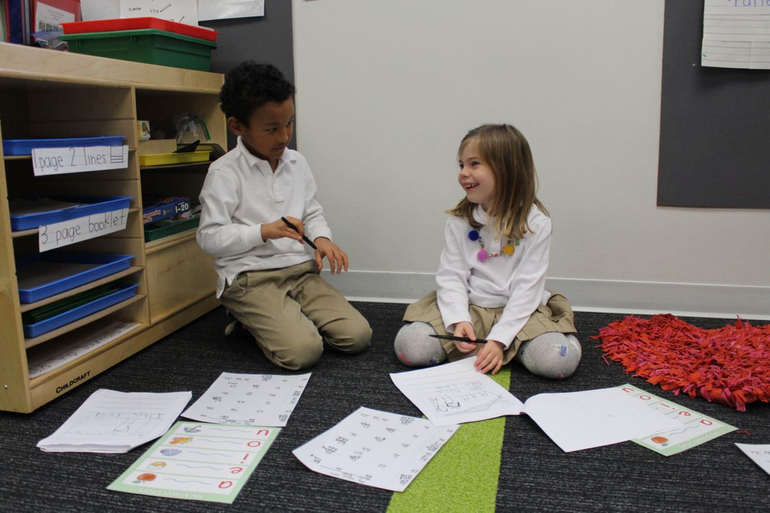 Alexandria Country Day School Photo #1 - Kindergartners confer with one another during Writing Workshop.