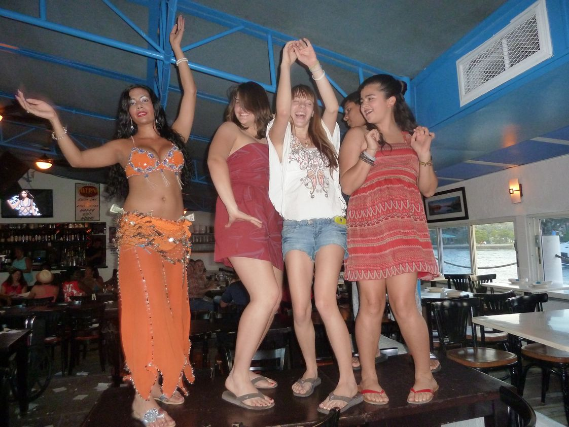 Conservatory Prep Senior High School Photo #1 - Our students take Latin as their foreign language and learn through music, theater and art. Mythology and ancient Greek and Roman culture is integrated into the curriculum. We have an active Latin club. In this photo the students 'let their hair down' at a recent family Greek night.