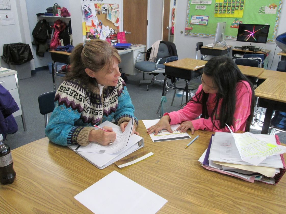 Harbour School At Baltimore Photo #1 - Teachers providing direct instruction to help a student. Harbour students benefit from small class sizes.