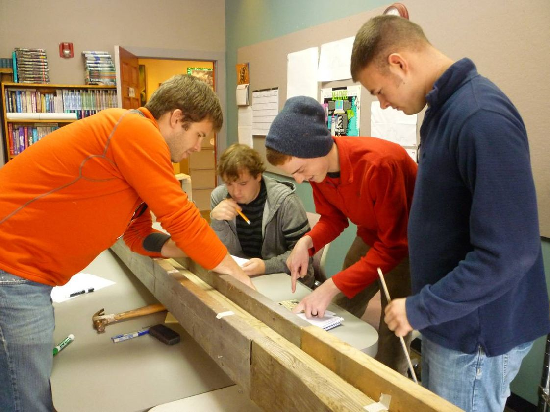 The New School Photo - TNS offers ample opportunities for hands-on learning. These math students are honing their skills with a carpentry project.