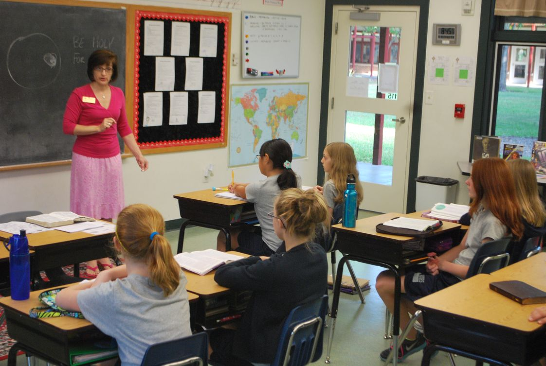 Covenant Academy Photo - Mrs. Collins with Sixth Grade