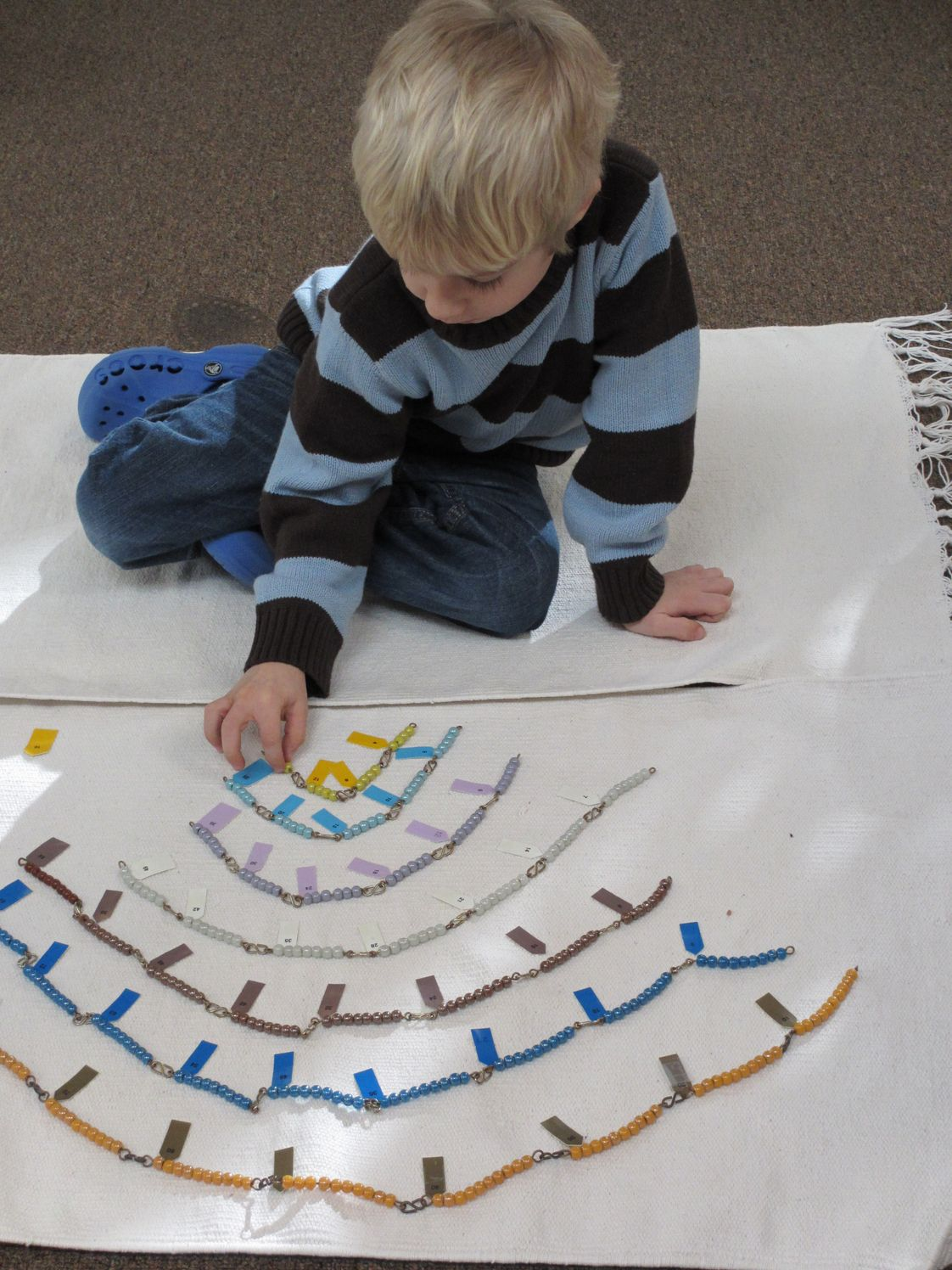 Follow the Child Montessori School Photo #1 - Math work in the 3-6 classroom (skip counting, ex: 2-4-6-8...)