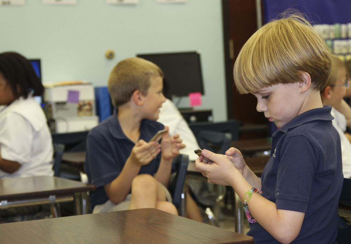 Christ Covenant School Photo #1 - Lower School students use iPod Touches to play interactive learning games in specific subjects.