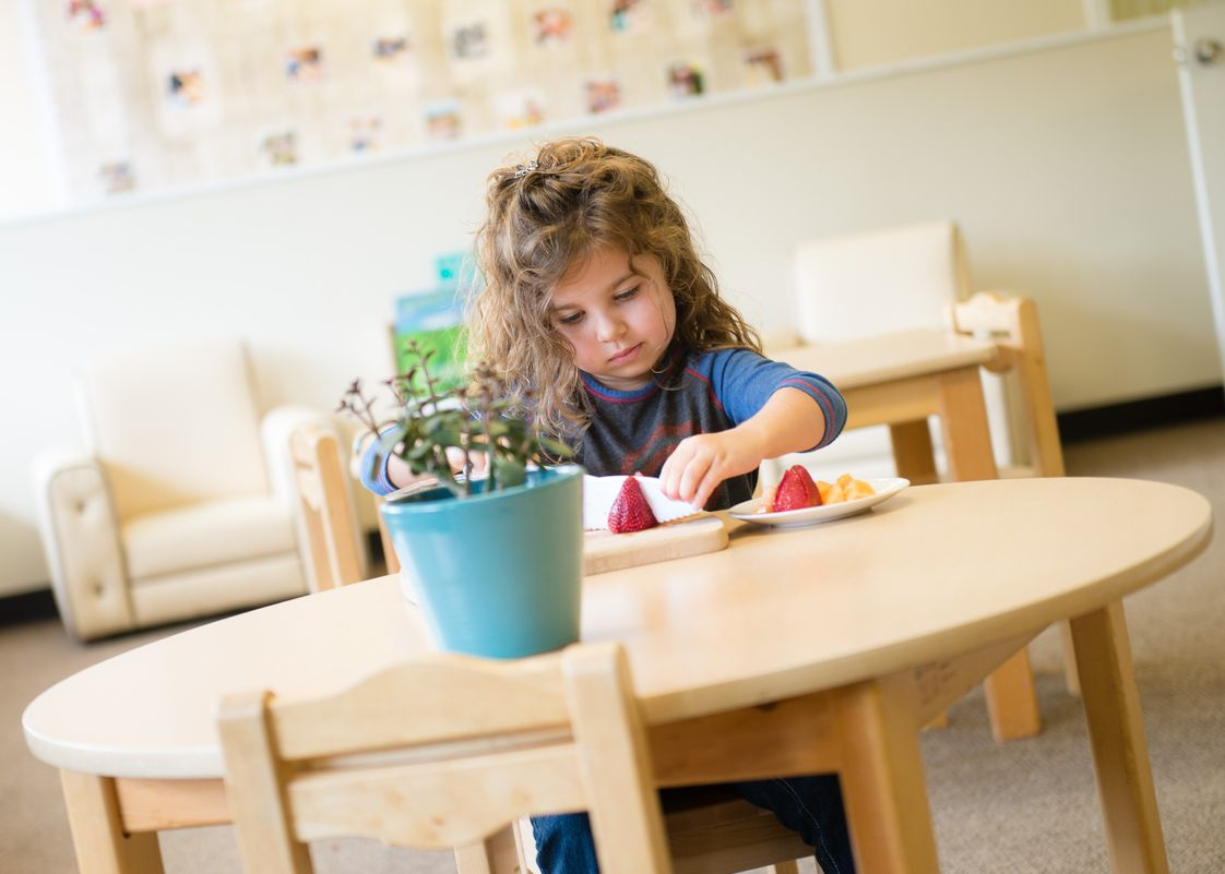 "Mission Montessori Photo - In a Montessori classroom, you will likely see a child doing something such as cutting fruit, washing dishes or watering the classroom plants. This is not pretend she is really participating in real work"" and is part of the classroom community."