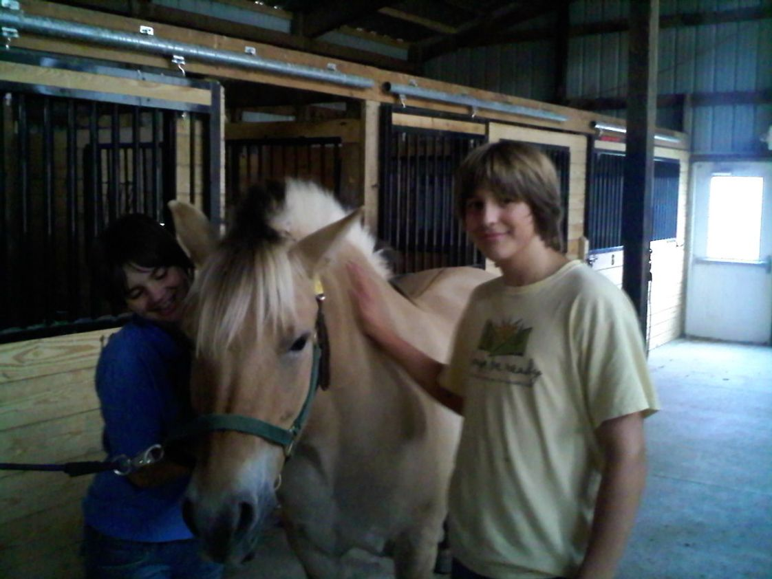 Elijah School Photo - Working with animals and cleaning the barn in advance of the annual horse show at Freedom Hills Therapeutic Riding