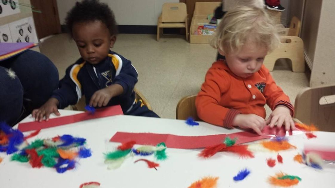 Edwardsville KinderCare Photo - Feather Headbands!
