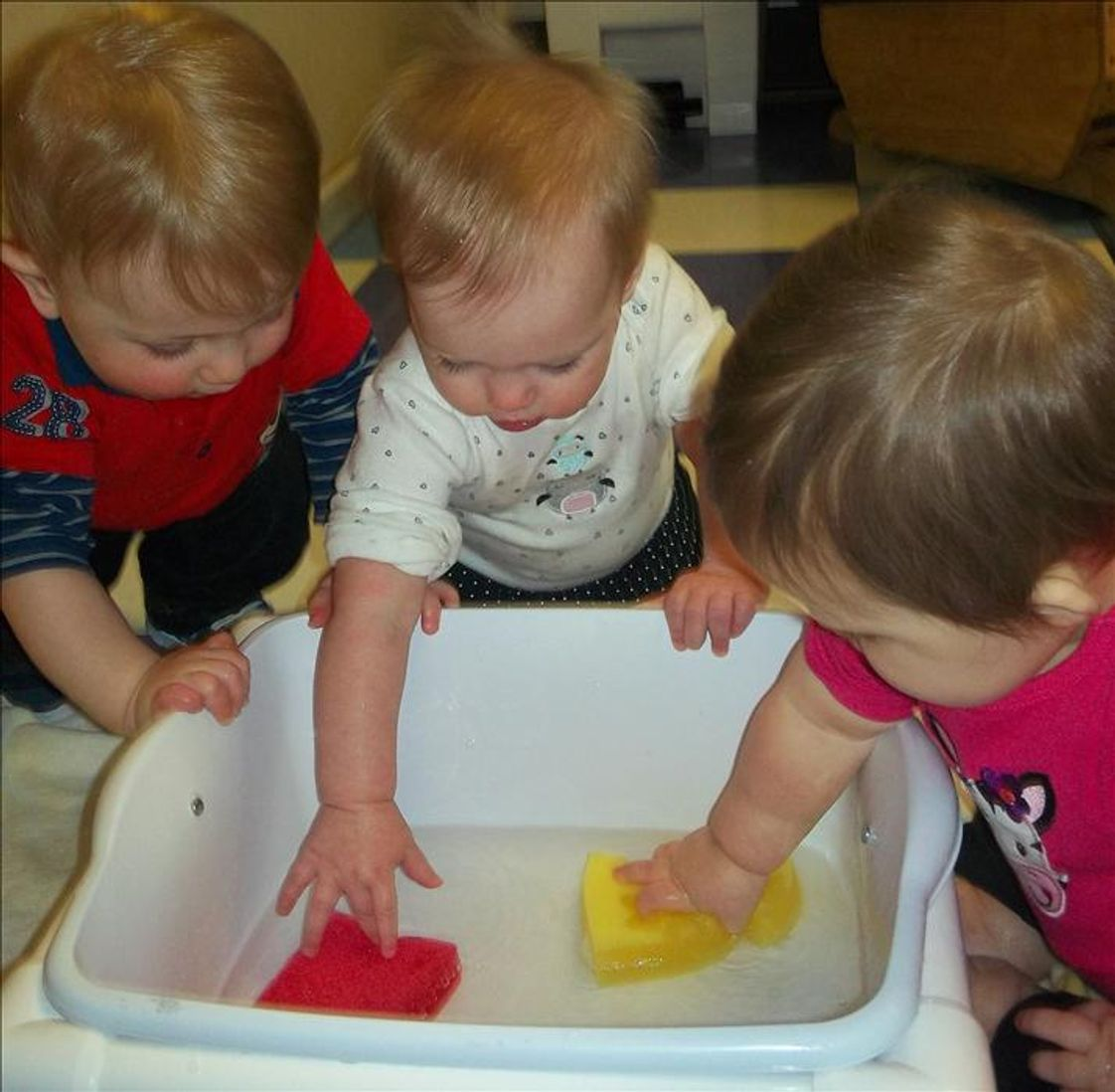 Center Grove KinderCare Photo - Exploring water in the infant classroom