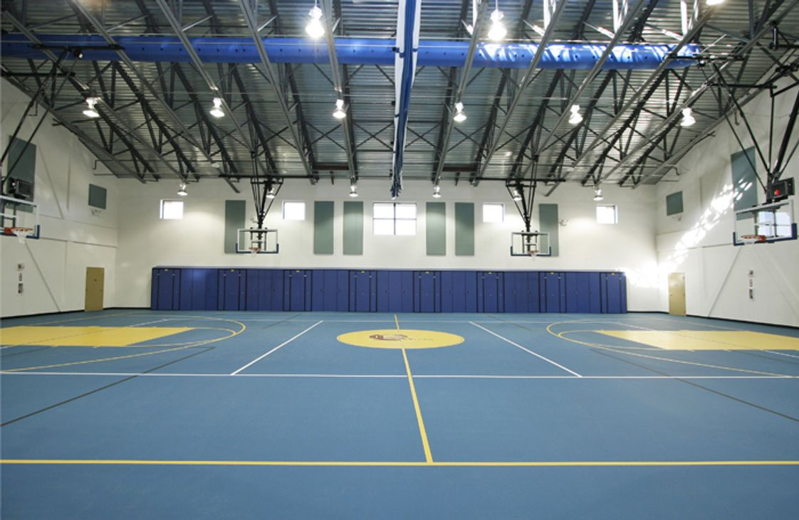 The Quarry Lane School Photo - Our state-of-the-art gymnasium is used for Physical Education classes, as well as hosting a variety of sports, including Basketball, Volleyball, Badminton and Futsal.