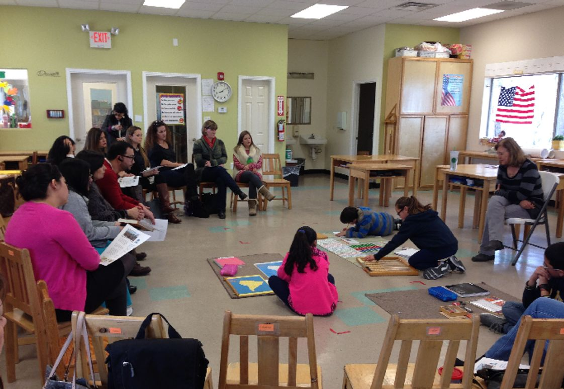 Mountain West Montessori School Photo - Children show their work to parents during a Parent Meeting.