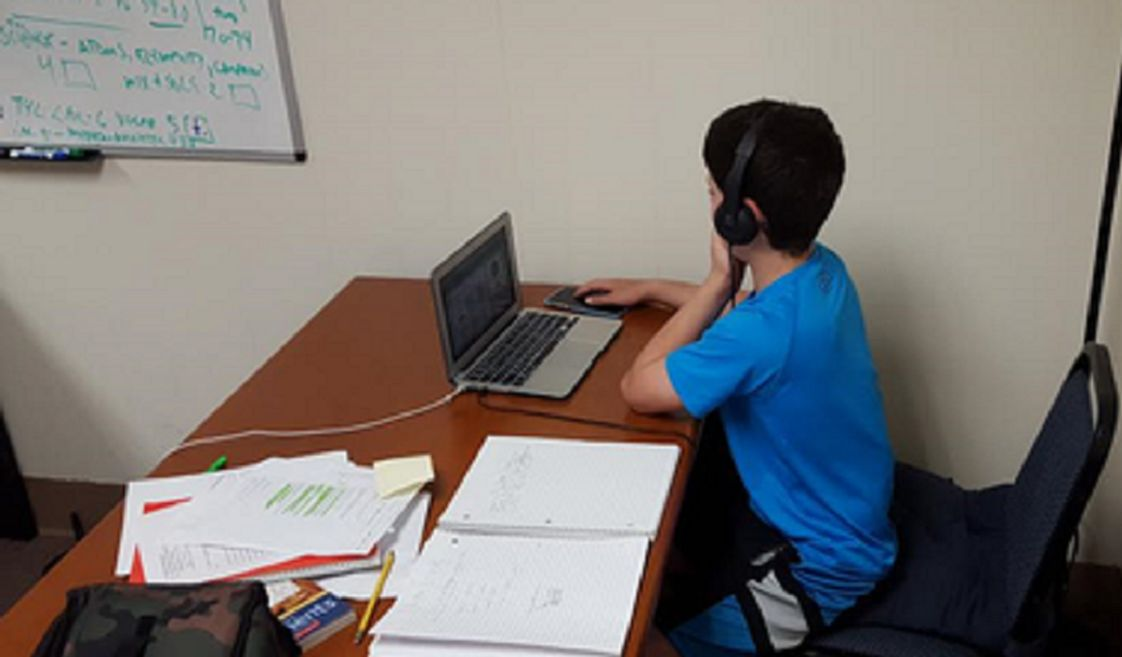 American Boys Preparatory Academy Photo - American Boys Prep student learning at his own pace.