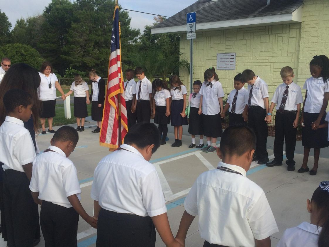 Light Christian Academy Photo - LCA students praying for our nation during chapel (2015-2016 school year)