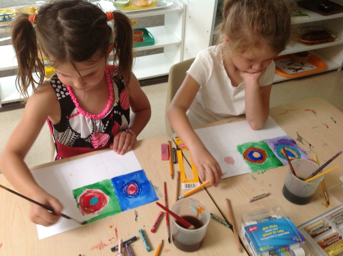 Montessori School At Lone Tree Photo #1 - Kindergarten children learn about artists. In this photo, they are painting in a style similar to Wassily Kandinsky.