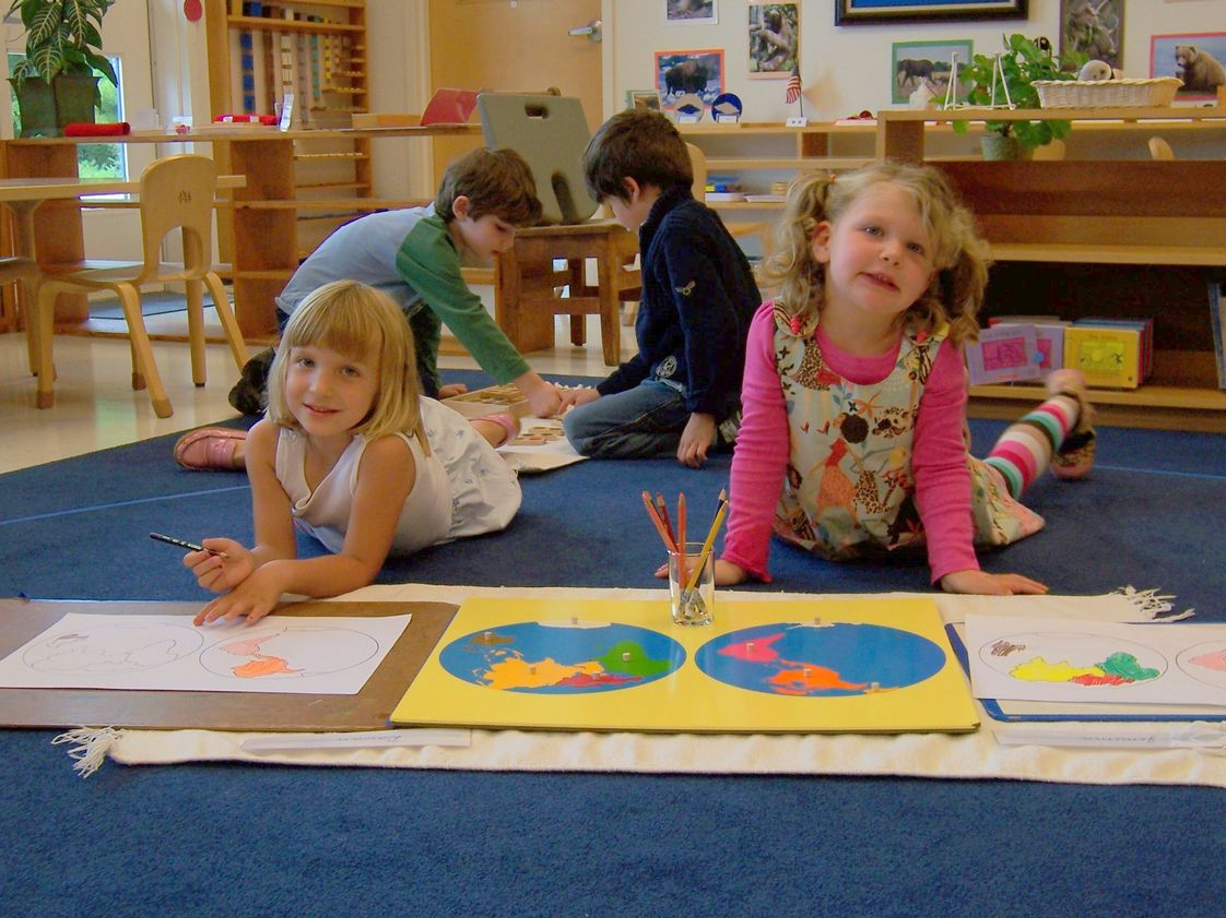 Washington Montessori School Photo #1 - The Lower School students (3-6 year olds) are curious about the world and the Montessori materials help them learn about geography and maps.