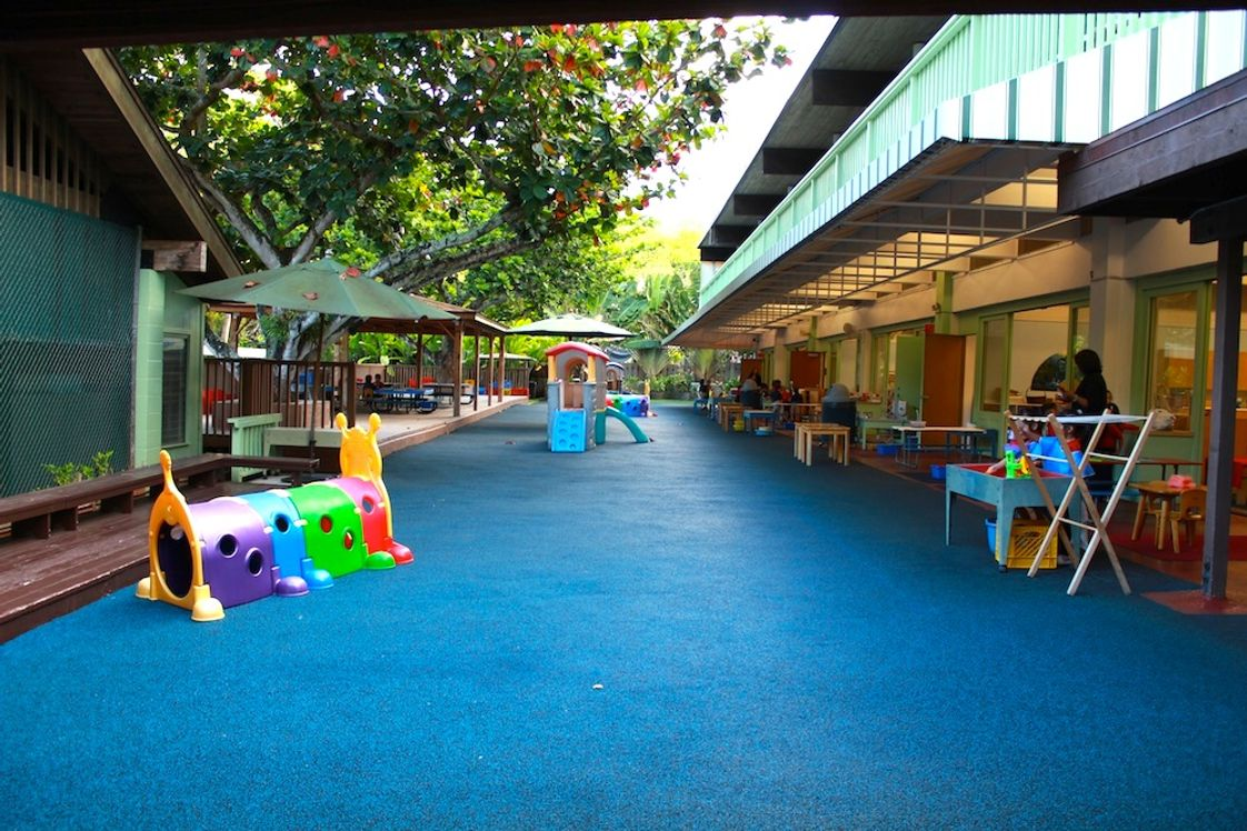 The Children's House Photo - Rubberized/Padded areas in front of the classrooms make for a fun, safe place to engage in activity.