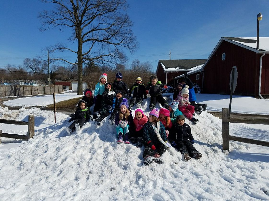Montessori Academy Photo #1 - Our kids spend time outside everyday, every season. Lightening and sub-zero temperatures will keep us indoors otherwise our motto is 'there's no bad weather only the wrong clothes!'