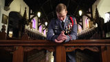 Cadet praying at the altar in our historic St. James Chapel.