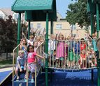 Kindergarten students enjoying time on one of our 5 amazing playgrounds