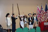 Fifth grade students re-enacting The Battle of Lexington and Concord as part of their Walk Through the American Revolution assembly.  On campus assemblies and off campus field trips are incorporated at each grade to complement the curriculum.