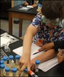 Journeys School of Teton Science Schools Photo - Students engaging in hands-on learning in science class.