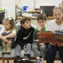 Saint Peter's School Photo #4 - 6th grade students reading to their Pre-K buddies