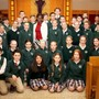 Monsignor Haddad Middle Photo - Lost child of Sudan Akuot Leek with the sixth grade after addressing the Monsignor Haddad student body.