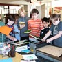 Community School Photo - Students learning about printmaking in art class.