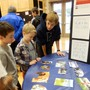 Princeton Montessori School Photo #3 - A Middle School student explains his science experiment at the annual Science Fair.