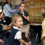 Rumson Country Day School Photo #3 - During a Spanish lesson, Beginners students are engaged through the use of music and movement.