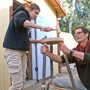 Davis Waldorf School Photo #9 - Here our woodworking teacher helps an eighth grade student in the building of a stool. Waldorf education aims to help children develop their IQ, EQ (emotional intelligence) and PQ (physical intelligence)-- integrating their intellectual and social-emotional capacities while giving them the practical experience of making things happen. Woodworking helps students exercise their ability to bring projects to fruition.