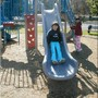Grace Lutheran School Photo #4 - Two third graders enjoying our upper grade playground equipment. Brand new equipment was installed in the lower grade and upper grade playgrounds over the summer of 2004. The lower grade playground had still more equipment installed during the 2004-05 school year.