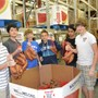 Fayetteville Academy Photo #5 - On Volunteer Day, a group of Fayetteville Academu seventh graders helped bag sweet potatoes at a local food bank.