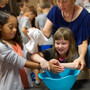 Eastern Mennonite School Photo #10 - Students wash each others' hands as they discuss the annual peace pledge and service to each other.