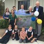 Fresta Valley Christian School Photo #1 - Fresta Valley founders and their grandchildren presenting our new gym plan